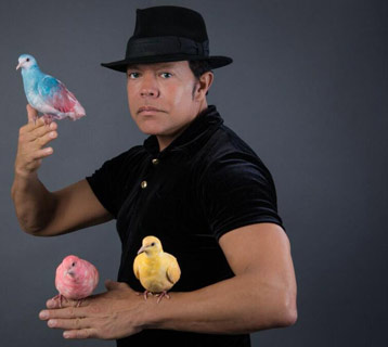 Magician with birds